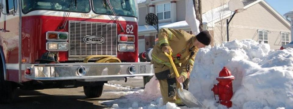 Palatine FD - Firefighter clearing snow from a fire hydrant